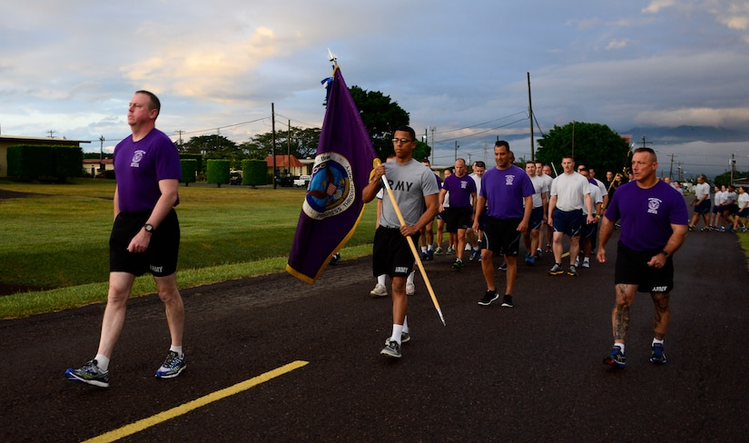 U.S. Army Col. Kirk Dorr, Joint Task Force-Bravo commander, leads the formation during the quarterly JTF-Bravo four-mile run at Soto Cano Air Base, Honduras, Nov. 21, 2014.  Once a quarter JTF-Bravo holds a formation run to encourage esprit de corps and physical fitness. (U.S. Air Force photo/Tech. Sgt. Heather Redman)