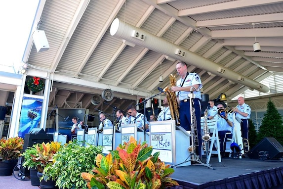The Airmen of Note performed recently at SeaWorld Orlando as part of a week-long community relations tour of Florida.  Master Sergeant Doug Morgan solos with the group on baritone saxophone. (U.S. Air Force Photo/released)
