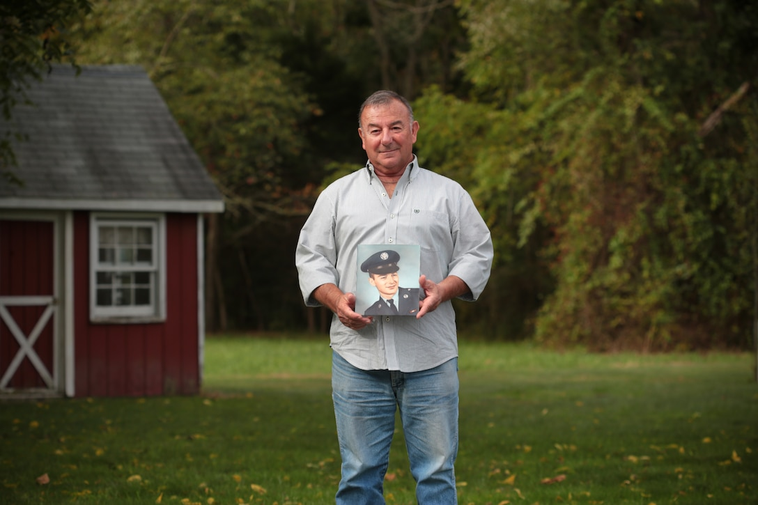 Retired New Jersey Air National Guard Master Sgt. Bob Hensel holds his basic training photo in his backyard in Buena, N.J., Oct. 7, 2014. Hensel is a Vietnam Veteran, who deployed to Phu Cat, South Vietnam. (U.S. Air National Guard photo by Tech. Sgt. Matt Hecht/Released)