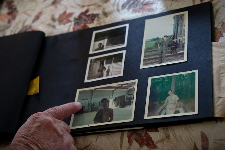 Retired New Jersey Air National Guard Master Sgt. Bob Hensel points out old photos in his home in Buena, N.J., Oct. 7, 2014. Hensel is a Vietnam Veteran, who deployed to Phu Cat, South Vietnam. (U.S. Air National Guard photo by Tech. Sgt. Matt Hecht/Released)