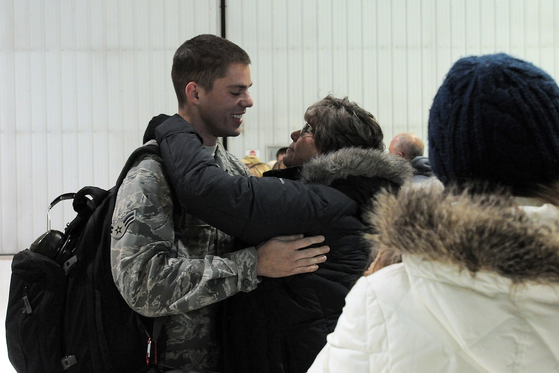 An Airman with the 123rd Contingency Response Group greets family members in Louisville, Ky., after returning home for a deployment to West Africa Nov. 19, 2014. The flight was the first of several bringing the unit home from overseas. (U.S. Army National Guard photo by Staff Sgt. Scott Raymond)