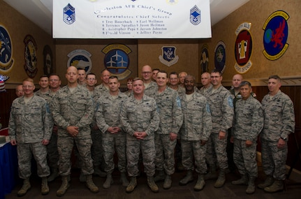 Chief master sergeants from Joint Base Charleston celebrate the promotion of Team Charleston's newest chief master sergeant selects: (from left displaying their new rank) Senior Master Sgt. Troy Bauerback, 437th Airlift Wing Operations Support Squadron, Senior Master Sgt. Terrence Spradley, 437th AW Maintenance Squadron, Senior Master Sgt. Jason Heilman, 628th Air Base Wing Security Forces Squadron, Senior Master Sgt. Earl Wellman, 437th AW Maintenance Group, Senior Master Sgt. Christopher Papa, 628th ABW Logistics Readiness Squadron, Senior Master Sgt. Harold Vinson, 315th Airlift Wing Yellow Ribbon Program Representative, and Senior Master Sgt. Jeffrey Payne, 315th AW Aircraft Maintenance Squadron. Not pictured is Senior Master Sgt. Jayson Johnston. (U.S. Air Force Photo / Senior Airman Tom Brading)