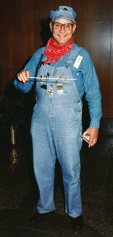 """Combining both his hobbies in one Halloween costume, Bob Fletcher shows up as a railroad engineer and/or musical """"conductor."""""""
