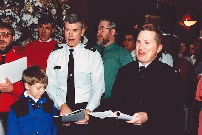 """Two more """"notches"""" for his conductor's baton, Bob Fletcher coaxed Col. (now retired Maj. Gen.) Michael Walsh and Brig. Gen. Peter Madsen (now retired), then commander of the U.S. Army Corps of Engineers South Pacific Division, to sing with the Corps-Aliers during a holiday performance."""" (Photo courtesy Bob Fletcher)"""