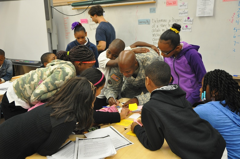 Lt. Col. John A. Knight, deputy commander, U.S. Army Corps of Engineers, New York District giving students his autograph after providing them some of his life lessons.