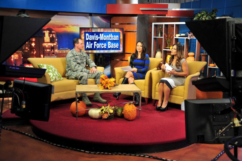 "U.S. Air Force Col. James P. Meger, 355th Fighter Wing commander, Davis-Monthan Air Force Base, Ariz., talks about D-M current events with local TV hosts, Tina Jennings and Maria Parmigiani, during a live recording of ""The Morning Blend"" show at KGUN9 Studio, Tucson, Ariz., Nov. 24, 2014.  Meger discussed his vision for D-M as well as the Total Force Training Environmental Assessment public comment timeline.  (U.S. Air Force Photo by Airman 1st Class Chris Massey/Released)"