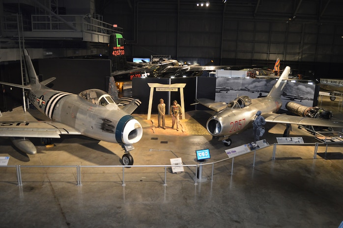 DAYTON, Ohio -- North American F-86A Sabre (left) on display with the Mikoyan-Gurevich MiG-15 in the Korean War Gallery at the National Museum of the United States Air Force. (U.S. Air Force photo)