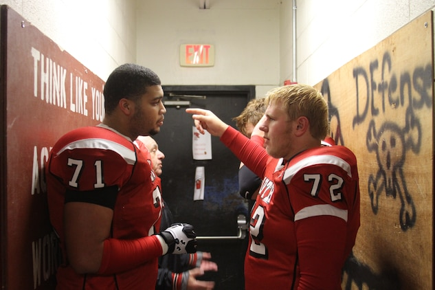 Rob Dowdy (left), a lineman with the Westerville South High School football team, talks to a teammate during halftime of the Westerville South versus Westerville North football game, Oct. 31, 2014. Rob has been officially selected to play in the Marine Corps Semper Fidelis All American Bowl, which will be held Jan. 4, 2015 in Carson, California. (U.S. Marine Corps photo by Cpl. Kyle Welshans/Released)