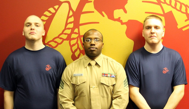 Twins Jacob (left) and Joshua (right) Nunnally, pose with their recruiter, U.S. Marine Corps Sgt. Andrew Franks, after earning their poolee shirts for swearing into the Marine Corps' Delayed Entry Program Nov. 3, 2014. The twins, from Greensville County, North Carolina, enlisted in the buddy program so they could attend boot camp together. (U.S. Marine Corps photo by Cpl. Aaron Diamant/Released)