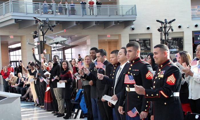 U.S. Marine Corps Sgt. Gustavo A. Arroliga, a recruiter with Recruiting Sub-Station Woodbridge and native of Nicaragua, waits for the Oath of Allegiance during a naturalization Ceremony held at the National Museum of the Marine Corps Nov. 10, 2014. His naturalization allows him to apply for a security clearance that is required for his job as a recruiter. (U.S. Marine Corps photo by. Cpl. Amber Williams/Released)