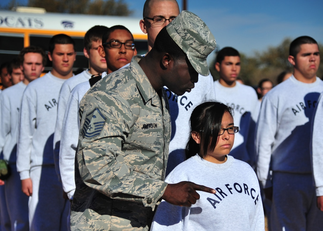 U.S. Air Force Master Sgt. Marvin Jimerson, 27th Special Operations Maintenance Squadron first sergeant and former basic military training technical instructor, questions a cadet during drill Nov. 21, 2014 at Cannon Air Force Base, N.M. Junior Reserve Officer Training Corps cadets with Clovis, New Mexico high school were provided military insight by an elite core of Air Commandos as part of a partnership effort with Cannon's local community. (U.S. Air Force photo/Staff Sgt. Alexxis Mercer)