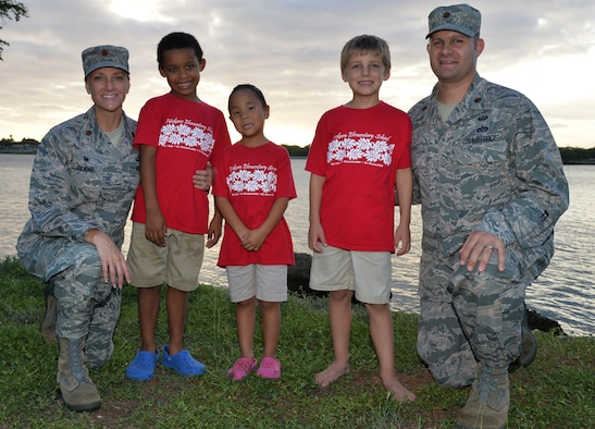 From left, Maj. Amanda Evans, Trevor, Katelyn, Parker, and Maj. Brian Evans pose for a photo Nov. 21, 2014, at Joint Base Pearl Harbor-Hickam, Hawaii. Amanda and Brian adopted Trevor and Katelyn, and Parker is their biological son. Amanda is the 15th Comptroller Squadron commander and Brian is a Special Operations Command Pacific air operations planner. (U.S. Air Force photo/Staff Sgt. Alexander Martinez)