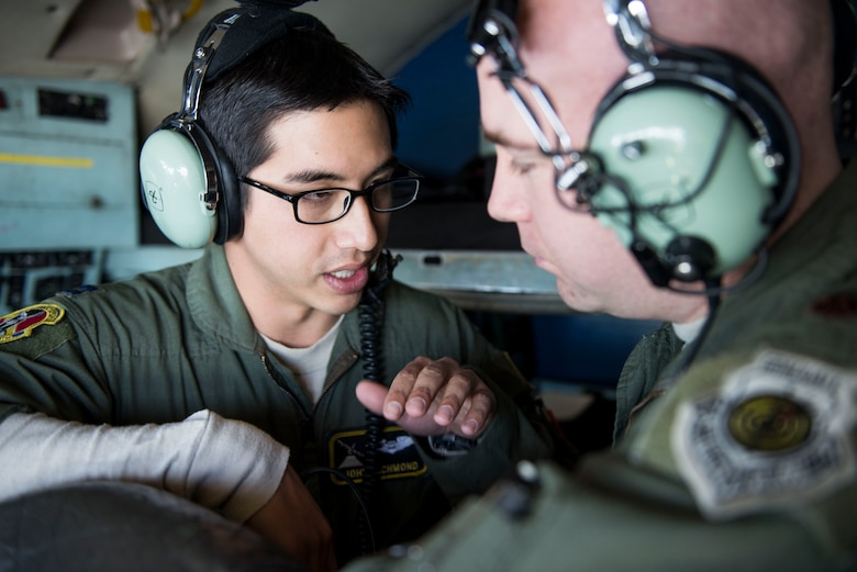 Capt. John Richmond communicates with Maj. Andrew Baker during Exercise Max Thunder Nov. 19, 2014, over South Korea. Richmond ensured his flight maintained their planned course during the exercise. Richmond is a 36th Airlift Squadron C-130 Hercules navigator and Baker is a 36th AS weapons and tactics flight commander. (U.S. Air Force photo/Staff Sgt. Cody H. Ramirez)