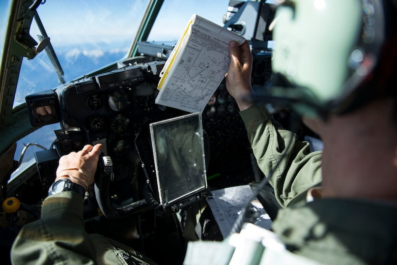 Capt. Shawn Hooton puts a map on display during a flight Nov. 19, 2014, over South Korea. Hooton and other members of the 36th Airlift Squadron flew to South Korea to participate in Max Thunder, a biannual exercise focused on improving the interoperability of the U.S.-South Korea partnership. Hooton is a 36th AS C-130 Hercules pilot. (U.S. Air Force photo/Staff Sgt. Cody H. Ramirez)