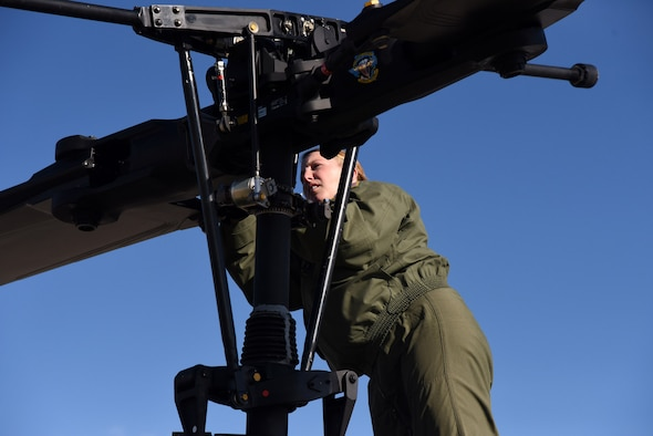 Tech. Sgt. Michelle Bresson performs a pre-flight inspection Nov. 5, 2014, at Malmstrom Air Force Base, Mont. Bresson is a 40th Helicopter Squadron special missions aviator and her responsibilities typically include keeping the pilots advised of anything that is going on with the aircraft – if there are any malfunctions with the aircraft, the aviators are the system experts. (U.S. Air Force photo/Airman 1st Class Joshua Smoot)