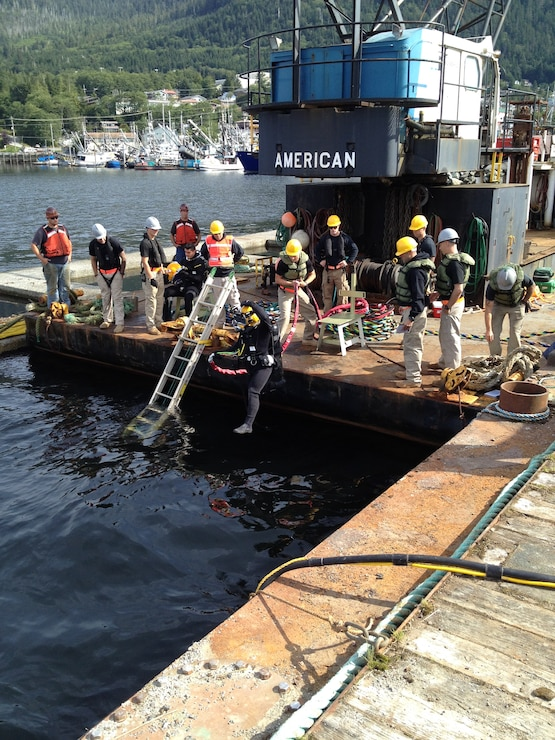 The 7th Dive Detachment begins work in August 2014 to repair the floating breakwaters at Bar Point Harbor in Ketchikan, Alaska.