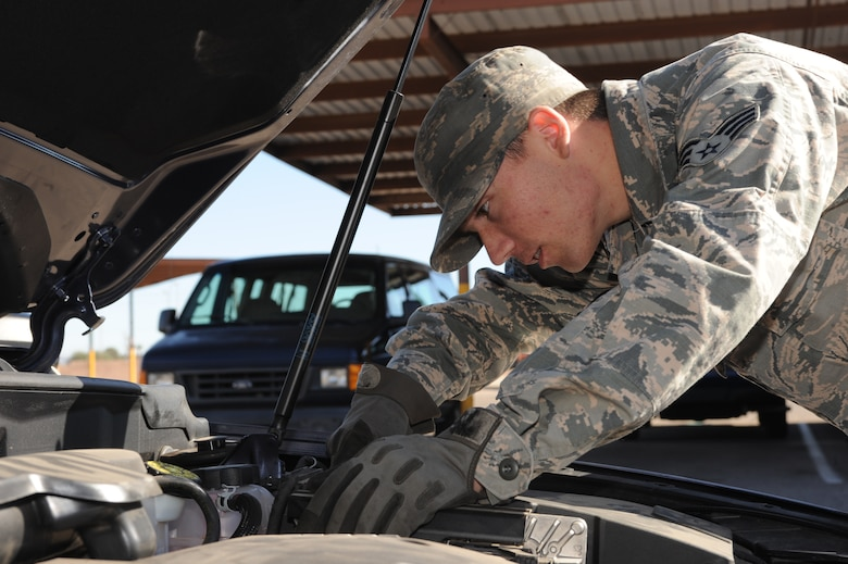 U.S. Air Force Senior Airman Andrew Liszewski, 355th Logistics Readiness Squadron vehicle operator and dispatcher, checks the fluid levels on a government-owned vehicle at Davis-Monthan Air Force Base, Ariz.,Nov. 18, 2014. Frequent fluid checks aid in the reliability of the vehicle. (U.S. Air Force photo by Airman 1st Class Cheyenne Morigeau/ Released)