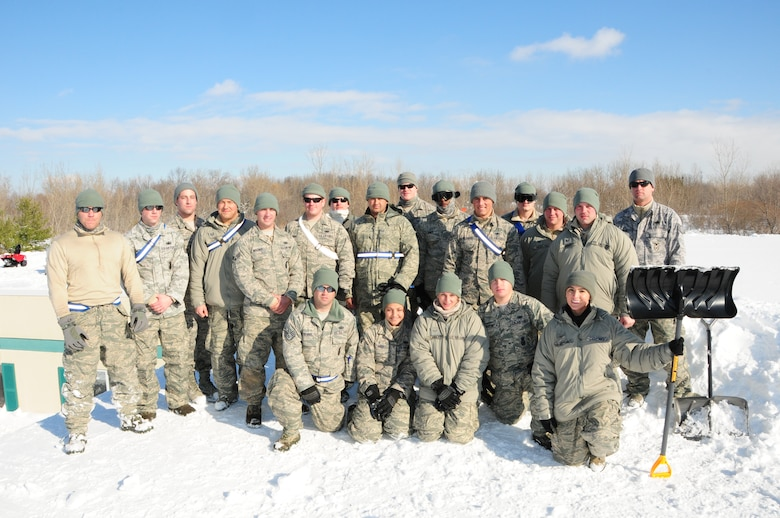 Airmen from the 107th Airlift Wing's Security Forces take a break from removing four feet of snow from the roof of Eden Heights Assisted Living Facility in West Seneca, New York which came from the snow storm that hit the Western New York area on Nov 18, 2014. (U.S. Air National Guard photo by Senior Master Sgt. Ray Lloyd)