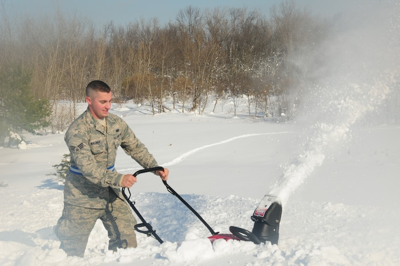 Senior Airman Robert Wagner from 107th Airlift Wing Security Forces takes part in removing the four feet of snow off the roof of Eden Heights Assisted Living Facility in West Seneca, New York from the snow storm that hit the Western New York area on Nov 18, 2014. (U.S. Air National Guard photo by Senior Master Sgt. Raymond Lloyd).