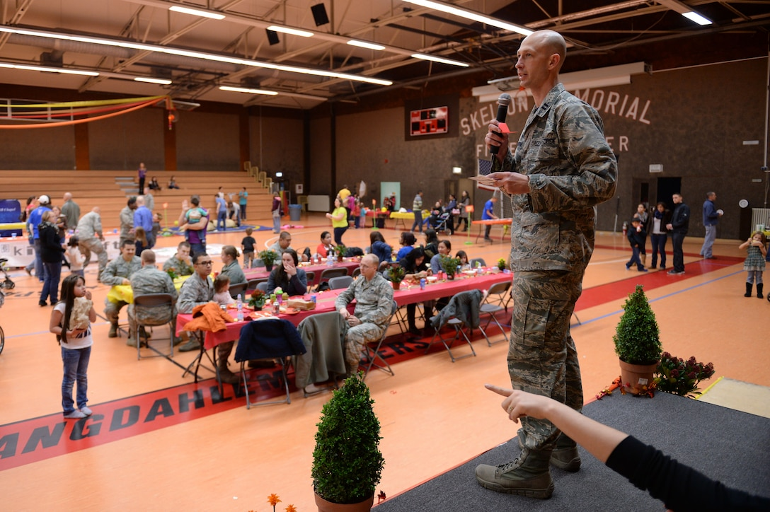 U.S. Air Force Chaplain (Capt.) Aaron Thorne, coordinator of Spantacular Family Fall Festival, selects a prize winner during the event Nov. 21, 2014, in the Skelton Memorial Fitness Center at Spangdahlem Air Base, Germany. Thorne drew names to randomly select participants to receive gifts. (U.S. Air Force photo by Staff Sgt. Daryl Knee/Released)
