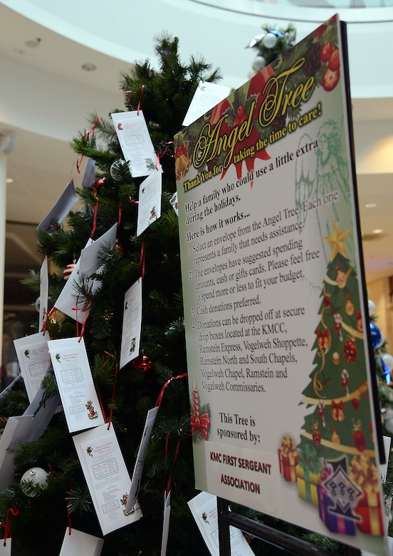 A sign explaining the 2014 Angel Tree program sits in the middle of the Kaiserslautern Military Community Center at Ramstein Air Base, Germany, Nov. 17, 2014. Angel Tree is an annual program led by the Kaiserslautern Military Community First Sergeant Council to help provide financial relief to military families during the holiday season. (U.S. Air Force photo/Senior Airman Timothy Moore)