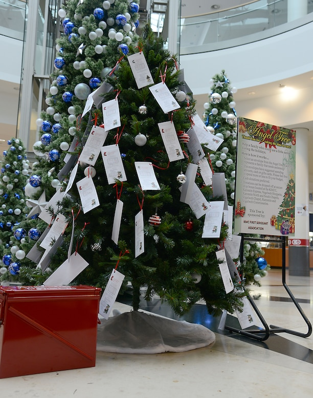 A tree, sign and donation collection box for the 2014 Angel Tree program sit in the middle of the Kaiserslautern Military Community Center at Ramstein Air Base, Germany, Nov. 17, 2014. Angel Tree is an annual program led by the Kaiserslautern Military Community First Sergeant Council to help provide financial relief to military families during the holiday season. (U.S. Air Force photo/Senior Airman Timothy Moore)
