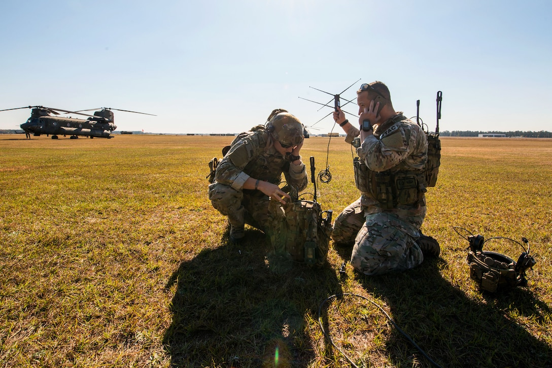 Airmen establish communications with aircraft during exercise Carolina Thunder 14 on McEntire Joint National Guard Base in Eastover, S.C., Nov. 15, 2014. The airmen are Tactical Air Control Party members assigned to the Georgia Air National Guard's 165th Air Support Operations Squadron. South Carolina, North Carolina and Georgia Guardsmen participated in the training exercise.