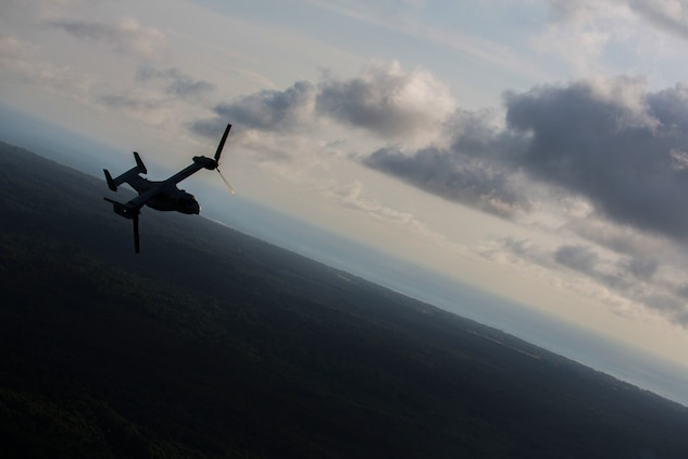A U.S. Marine Corps MV-22B Osprey with SPMAGTF Crisis Response - Africa returns to base after dropping off supplies that will be used by local and international health organizations to build Ebola Treatment Units while in support of Operation United Assistance in Liberia, Nov. 21, 2014. United Assistance is a Department of Defense operation to provide command and control, logistics, training, and engineering support to U.S. Agency for International Development- led efforts to contain the Ebola virus outbreak in West African nations. (U.S. Marine Corps photo by Lance Cpl. Andre Dakis/SPMAGTF-CR-AF Combat Camera/Released)