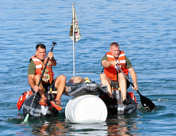 Lt. Col. Robert Bailey, director of the Amphibious Vehicle Test Branch, and Master Sgt. Michael Chouinard, AVTB staff noncommissioned officer in charge, row their team's makeshift boat Nov. 21 at Camp Pendleton, Calif. AVTB, a subordinate unit of Marine Corps Systems Command, held its inaugural bathtub race where participants were challenged to build boats out of scavenged and recycled materials.