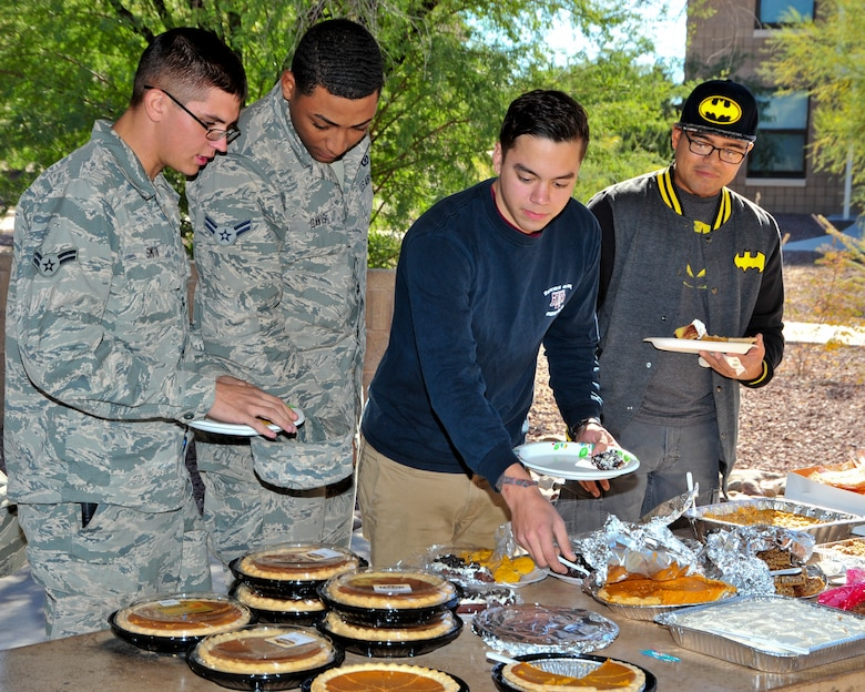 U.S. Air Force Airmen review dessert options during a Thanksgiving Dorm Bash held at Davis-Monthan Air Force Base, Ariz., Nov. 25, 2014. The bash was held for dorm residents, who may not be going home for the holiday, the opportunity to enjoy a home-cooked meal. (U.S. Air Force Photo by Airman 1st Class Chris Massey/Released)