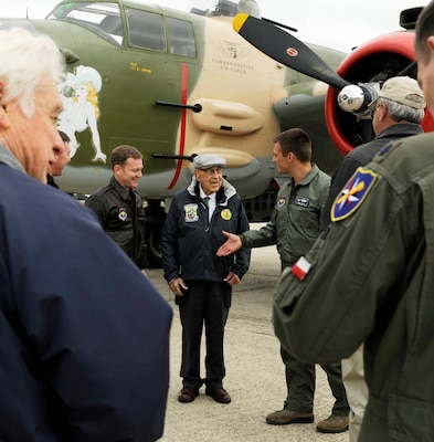 Lt. Col. Robert Bryant III (right), 559th Flying Training Squadron commander, greets retired Lt. Col. Richard Cole (center), former Doolittle Raider, Nov. 14 at Joint Base San Antonio-Randolph. At left is Lt. Col. Jeremy Seals, 559th FTS director of operations. For the complete story of Cole's visit, see page 6.