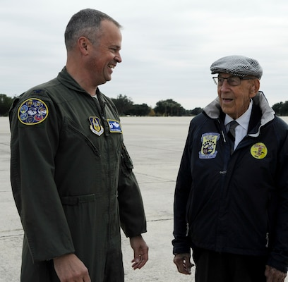 "Col. Brian Bowman (left), 340th Flying Training Group commander, greets retired Lt. Col. Richard Cole Nov. 14 on the Joint Base San Antonio-Randolph flight line. Cole is one of four living Doolittle Raiders and the copilot of the original B-25 ""Yellow Rose.""