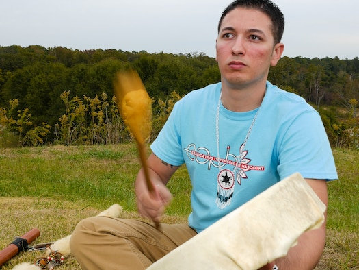 U.S. Air Force Staff Sgt. Kelvin Oxendine, an airborne operations technician with the 116th Air Control Wing, Georgia Air National Guard, plays a Native American hand drum he created, Ocmulgee National Monument, Macon, Ga., Nov. 5, 2014. Oxendine is a member of the Lumbee Indian tribe out of Robeson County, North Carolina. The tribe has more than 55,000 members with two of the members serving together in the Georgia Air National Guard at Robins Air Force Base. Oxendine and a fellow Airman are descendants of Henry Berry Lowry, a young Native American Revolutionist who rose up in 1865 to fight injustice being directed against his people who are the modern day Lumbee Indians. Lowry came to be known as the Indian Robin Hood for his exploits. (U.S. Air National Guard photo by Master Sgt. Roger Parsons/Released)