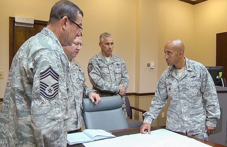 U.S. Air Force Maj. Charles Jacobs, right, detachment commander of the 202nd Engineering Installation Squadron, Georgia Air National Guard, meets with senior leaders of the squadron to discuss plans for an upcoming project, Robins Air Force Base, Ga., Nov. 4, 2014. Jacobs is a member of the Lumbee Indian tribe out of Robeson County, North Carolina. The tribe has more than 55,000 members with two of the members serving together in the Georgia Air National Guard at Robins Air Force Base. Jacobs and a fellow Airman are descendants of Henry Berry Lowry, a young Native American Revolutionist who rose up in 1865 to fight injustice being directed against his people who are the modern day Lumbee Indians. Lowry came to be known as the Indian Robin Hood for his exploits. (U.S. Air National Guard photo by Master Sgt. Roger Parsons/Released)