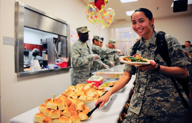 Airman 1st Class Danielle Conde, 6th Air Mobility Wing photojournalist, poses for a photo during the dorm resident Thanksgiving dinner at MacDill Air Force Base, Fla., Nov. 24, 2014. Due to the dining facility closure, private organizations on base teamed up with the local United Service Organization to put together a Thanksgiving feast for the dorm residents. (U.S. Air Force photo by Senior Airman Melanie Bulow-Gonterman/Released)