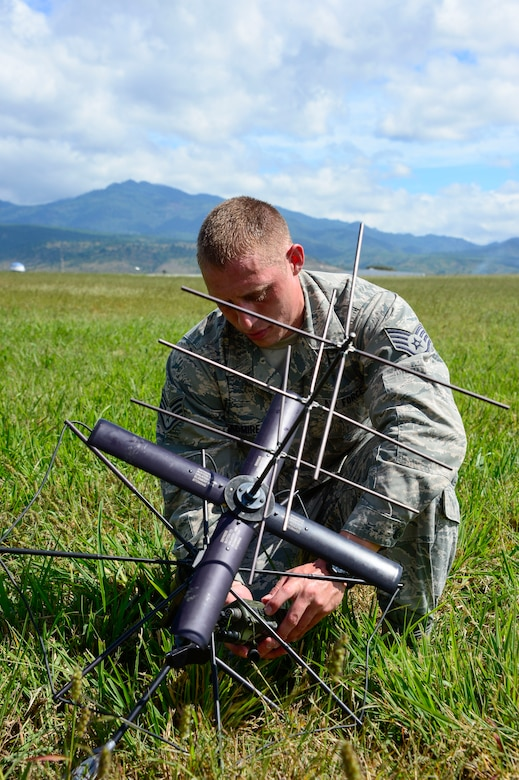 U.S. Air Force Staff Sgt. Brent Admire, Joint Task Force Bravo communications operations non-commissioned officer, sets up a ground radio during air load and fly-away training on Soto Cano Air Base, Honduras, Nov. 25, 2014.  During the training members of the U. S. Southern Command Situational Assessment Team received training on setting up a Pre-Positioned Expeditionary Assistance Kit to help prepare the team respond efficiently to humanitarian assistance and disaster response situations throughout U.S. Southern Command's area of responsibility.  The training focused on S-SAT familiarization, hands on training and a  fly-away event between JTF-Bravo S-SAT personnel, Army Forces Battalion, and 1-228th Aviation Regiment in preparation for an upcoming exercise. (U.S. Air Force photo/Tech. Sgt. Heather Redman)