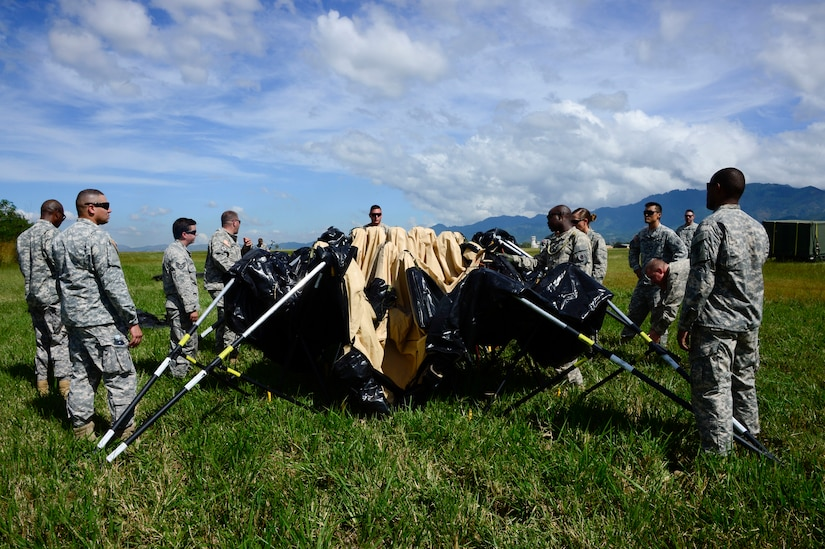 Members from the Joint Task Force-Bravo U. S. Southern Command Situational Assessment Team learn to set up a Deployable Rapid Assembly Shelter during air load and fly-away training on Soto Cano Air Base, Honduras, Nov. 25, 2014.  The members of the S-SAT received training on setting up a Pre-Positioned Expeditionary Assistance Kit to help prepare the team respond efficiently to humanitarian assistance and disaster response situations throughout U.S. Southern Command's area of responsibility.  The training focused on S-SAT familiarization, hands on training and a fly-away event between JTF-Bravo S-SAT personnel, Army Forces Battalion, and 1-228th Aviation Regiment in preparation for an upcoming exercise. (U.S. Air Force photo/Tech. Sgt. Heather Redman)