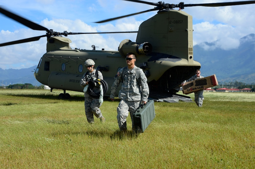 Members from the Joint Task Force-Bravo U. S. Southern Command Situational Assessment Team unload equipment from a CH-47 Chinook during air load and fly-away training on Soto Cano Air Base, Honduras, Nov. 25, 2014.  The members of the S-SAT received training on setting up a Pre-Positioned Expeditionary Assistance Kit to help prepare the team respond efficiently to humanitarian assistance and disaster response situations throughout U.S. Southern Command's area of responsibility.  The PEAK is designed to provide sustainable, essential services in the first 72 hours after a disaster event. The training focused on S-SAT familiarization, hands on training and a fly-away event between JTF-Bravo S-SAT personnel, Army Forces Battalion, and 1-228th Aviation Regiment in preparation for an upcoming exercise.  (U.S. Air Force photo/Tech. Sgt. Heather Redman)
