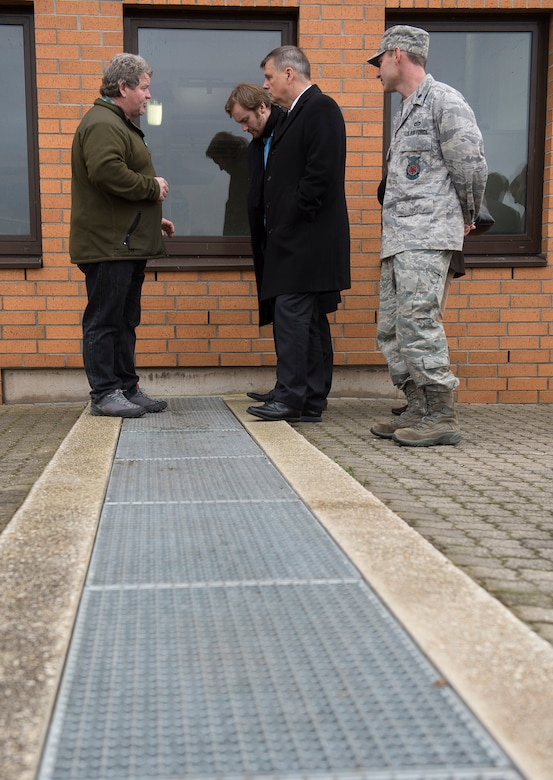 Peter Thiel, 52nd Civil Engineer Squadron waste water treatment foreman, left, and U.S. Air Force Lt. Col. Christopher Meeker, 52nd CES commander, right, discuss water treatment procedures with Dr. Ulrich Kleemann, SGD-Nord president, center, at the waste water plant near Spangdahlem Air Base, Germany, Nov. 20, 2014. SGD-Nord, the environmental protection organization for the Rhineland-Pfalz region, acts as a field agency that reports directly to the state ministries, and oversees regional project planning, environmental compliance issues, water drainage, nature conservation, land acquisition and compensation issues, building standards control and redevelopment of hazardous waste sites. Base leaders invited Kleemann on a tour to discuss the wing's continuing commitment to responsible stewardship of the environment and prospects for partnering with SGD-Nord. (U.S. Air Force photo by Staff Sgt. Chad Warren/Released)