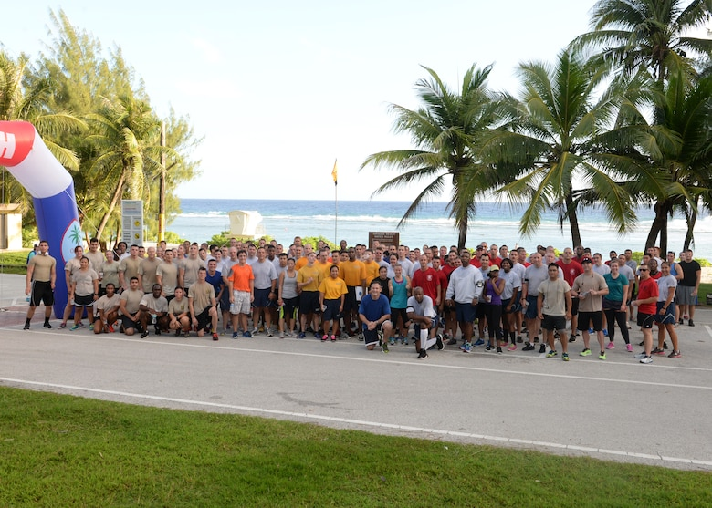 Participants of the 2014 Gobble Wobble 5K Fun Run gather together for a group photo after the event at Tarague Beach at Andersen Air Force Base, Guam. Approximately 100 people participated in the Gobble Wobble as part of the monthly 5K event conducted by Coral Reef Fitness Center Airmen. (U.S. Air Force photo by Senior Airman Katrina M. Brisbin/Released)