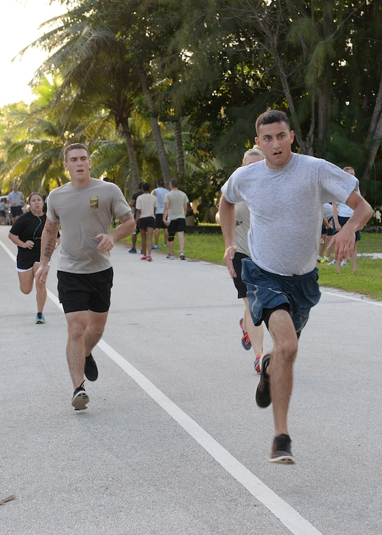 Team Andersen Airmen race to the finish line during the 2014 Gobble Wobble 5K Fun Run Nov. 26, 2014, at Tarague Beach at Andersen Air Force Base, Guam. Airmen participated in the event to build resiliency by focusing on the Comprehensive Airman Fitness pillar of physical fitness. (U.S. Air Force photo by Senior Airman Katrina M. Brisbin/Released)