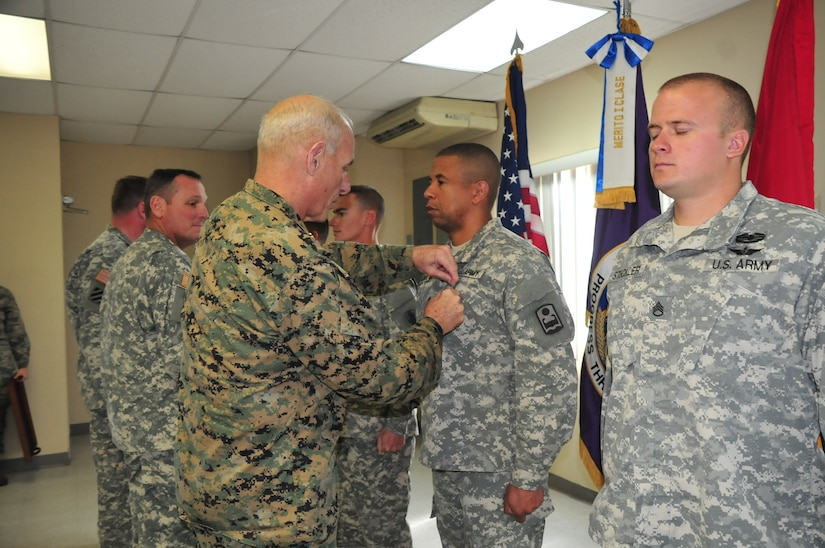U.S. Marine General John Kelly, Commander, U.S. Southern Command, presents five service members with the Army Commendation Medal at Soto Cano Air Base, Honduras, Nov. 27, 2014.  The service members were recognized for their distinguished achievements during their tour here.  General Kelly visited Soto Cano Air Base to celebrate Thanksgiving with the service members here. (U.S. Air Force photo by Capt. Connie Dillon)
