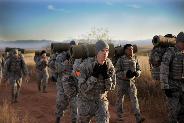 Airman 1st Class Koleton Mitchell participates in a 7-mile-long ruck alongside fellow Airmen at Fort Huachuca, Ariz., Nov. 18, 2014. The ruck kicked-off a field training exercise culminating the Army Weather Support Course intended to integrate Airmen with Soldiers before they deploy with an Army unit. Mitchell is a 25th Operational Weather Squadron weather forecaster. (U.S. Air Force photo/Airman 1st Class Chris Drzazgowski)