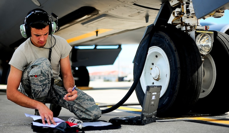 Senior Airman Daryn Petrie annotates fuel servicing to a KC-135 Stratotanker at MacDill Air Force Base, Fla., Oct. 30, 2014. The KC-135 can hold up to 200,000 lbs. of fuel and can be used as a medical evacuation aircraft. Petrie is a 6th Aircraft Maintenance Squadron crew chief. (U.S. Air Force photo/Senior Airman Melanie Bulow-Gonterman)
