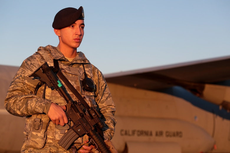 Airman 1st Class Abdiel Rivera walks the perimeter of a C-130J Hercules, Nov. 19, 2014. The aircraft is from 146th Airlift Wing based out of Channel Islands Air National Guard Base, Oxnard, Calif. Rivera is a security forces specialist from the New Jersey Air National Guard's 177th Security Forces Squadron. (U.S. Air National Guard photo/Tech. Sgt. Matt Hecht)
