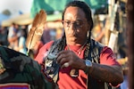 Tony LittleHawk, an Army Vietnam veteran, Cherokee tribe member and sun dancer, performs a spiritual cleansing and prayer with white sage he picked himself during the Native American Veterans Association's annual Veterans Appreciation and Heritage Day Pow Wow in South Gate, Calif., Nov. 8, 2014. DoD photo by Marvin Lynchard