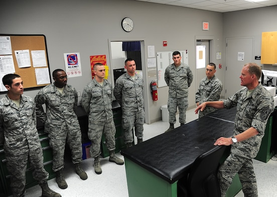 Chief Master Sgt. of the Air Force James A. Cody speaks with 14th Operation Support Squadron aircrew flight equipment members Sept. 24,2014, during his visit to Columbus Air Force Base, Miss. Cody and his wife, retired Chief Master Sgt. Athena Cody, took time to meet with Airmen and discuss several of the Air Force's current hot topics during the visit. (U.S. Air Force photo/Airman Daniel Lile)