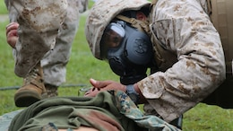 Petty Officer 2nd Class Tyrone Kimbrough, a corpsman with Alpha Company, 2nd Medical Battalion, 2nd Marine Logistics Group, checks a simulated casualty for injuries during a medical exercise aboard Marine Corps Base Camp Lejeune, N.C., Sept. 24, 2014. During the exercise, the corpsmen practiced stabilizing casualties for evacuation under stressful conditions to imitate situations they may experience in combat. (U.S. Marine Corps photo by Pfc. Olivia C. McDonald/Released)