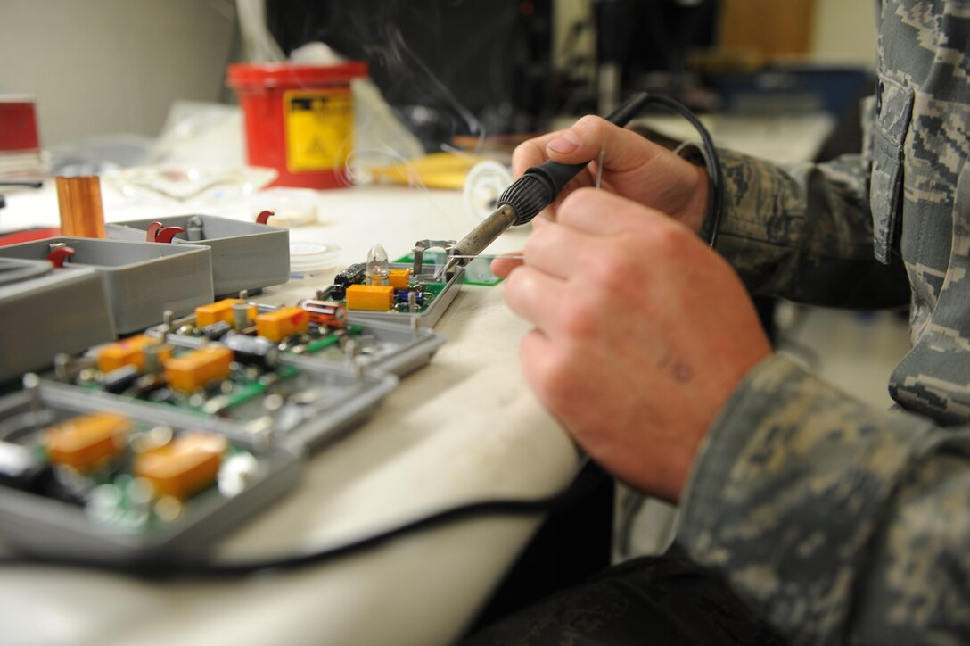 Senior Airman Jonathan Beres solders a C130J Super Hercules emergency light circuit board at Dyess Air Force Base, Texas. Beres is a technician with the 7th Maintenance Group Air Force Repair/Enhancement Program. One of the main areas of focus in the shop is circuit cards, which are costly to replace and often essential to an aircraft's mission. (U.S. Air Force photo by 2nd Lt. Lauren Linscott)