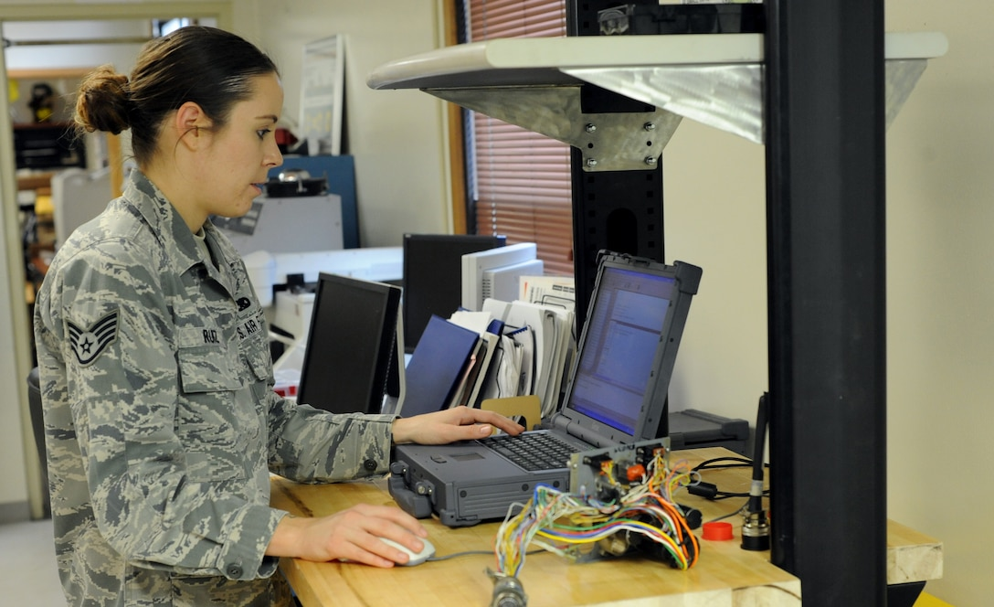 Staff Sgt. Aimee Ruiz tests the resistance and voltage in a B-1B Lancer circuit panel at Dyess Air Force Base, Texas. Ruiz is an Eclypse programmer with 7th Maintenance Group. The Eclypse program is still in development, but if approved, could be used throughout the entire U.S. Air Force's B-1B program to test and evaluate malfunctioning circuit cards. (U.S. Air Force photo by 2nd Lt. Lauren Linscott)